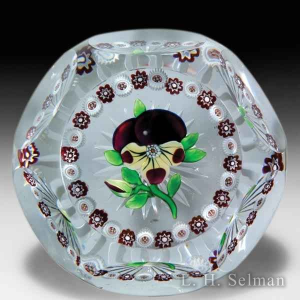 Antique Baccarat pansy and bud with millefiori garland faceted paperweight. by  Baccarat Antique