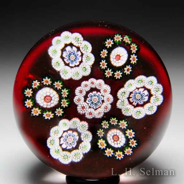 Antique Baccarat millefiori circlets paperweight. by  Baccarat Antique