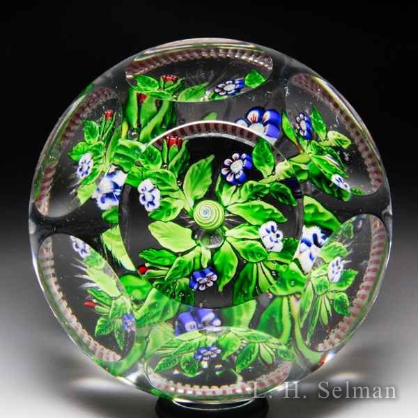 Rare antique Baccarat stylized cruciform floral bouquet faceted footed glass paperweight. by  Baccarat Antique