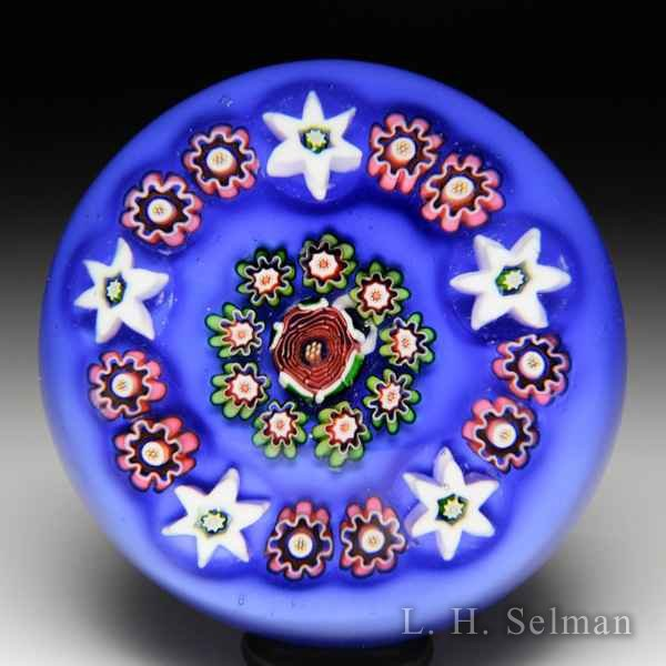 Antique Baccarat concentric millefiori over opaque blue miniature paperweight. by Baccarat Antique