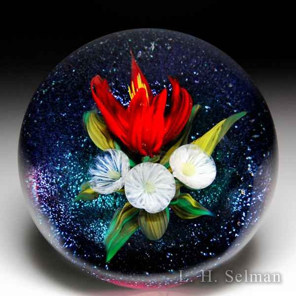 Melissa Ayotte 2017 red dahlia bouquet on iridescent ground paperweight. by Melissa Ayotte