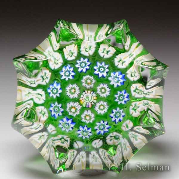 John Deacons (2016) green concentric millefiori miniature star-pressed paperweight. by John Deacons