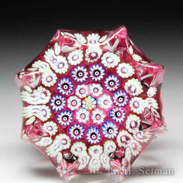 John Deacons (2016) pink concentric millefiori miniature star-pressed paperweight. by John Deacons