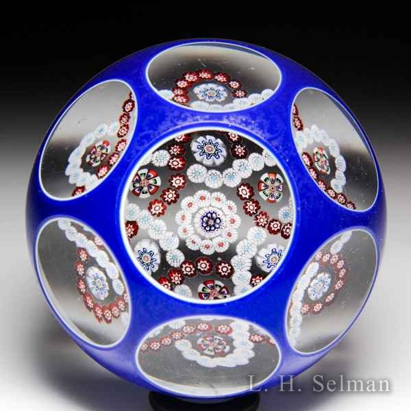 Antique Baccarat interlaced millefiori trefoil garlands in blue double overlay faceted glass paperweight. by  Baccarat Antique