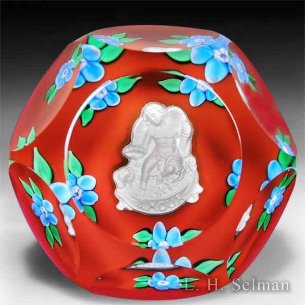Saint Louis 1979 'Amour' faceted Cupid sulphide glass paperweight. by  Saint Louis