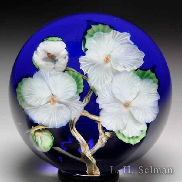 Lundberg Studios 1990 'Apple Blossoms' glass paperweight, by Daniel Salazar. by  Lundberg Studios