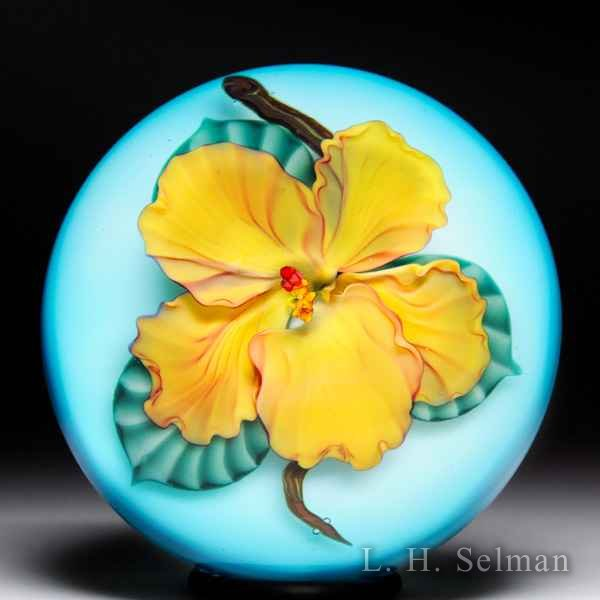 Lundberg Studios 2014 yellow hibiscus glass paperweight, by Daniel Salazar. by  Lundberg Studios