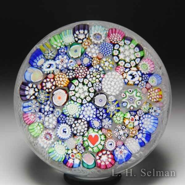 John Deacons 2014 close packed millefiori on upset muslin glass paperweight. by John Deacons