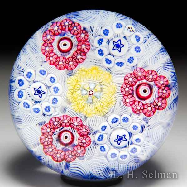 Baccarat 1973 millefiori circlets on upset muslin paperweight. by Baccarat Moderns