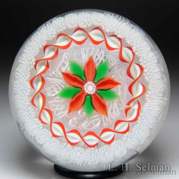 John Deacons 2015 red poinsettia and torsade paperweight. by John Deacons