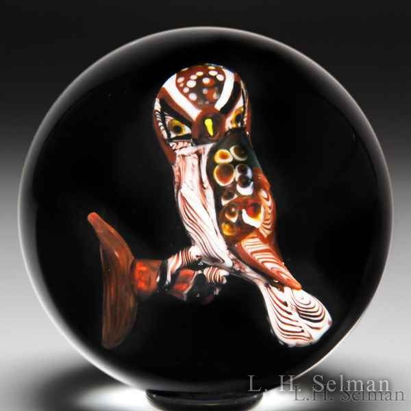 Rick Ayotte 1980 'Hawk Owl' glass paperweight, from the Bird of Prey series. by Rick Ayotte