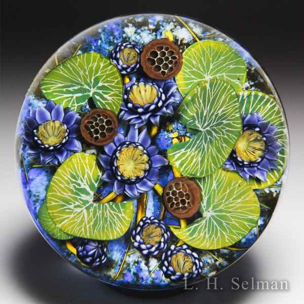 David Graeber 2017 purple water lilies glass paperweight. by David Graeber