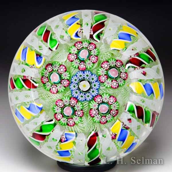 John Deacons 2017 patterned millefiori crown faceted glass paperweight. by John Deacons