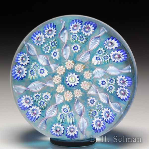 John Deacons radial spokes patterned glass paperweight. by John Deacons
