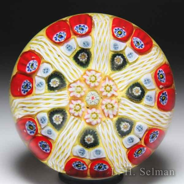 Strathearn radial spokes on yellow ground glass paperweight. by  Strathearn Glass