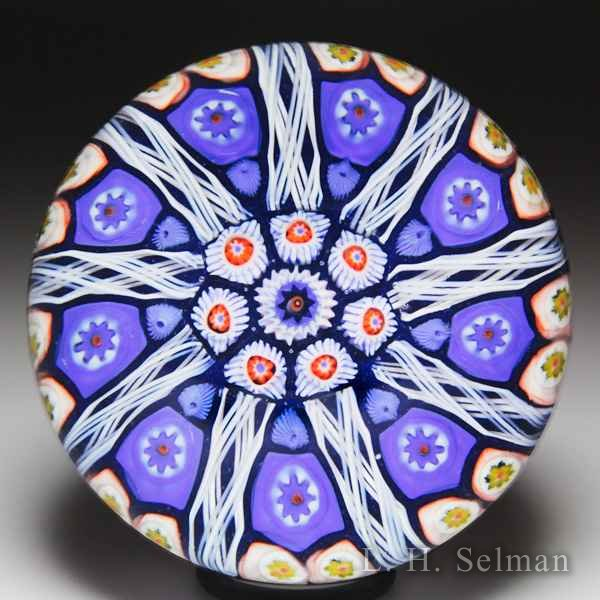 Strathearn radial spokes on blue ground glass paperweight. by  Strathearn Glass