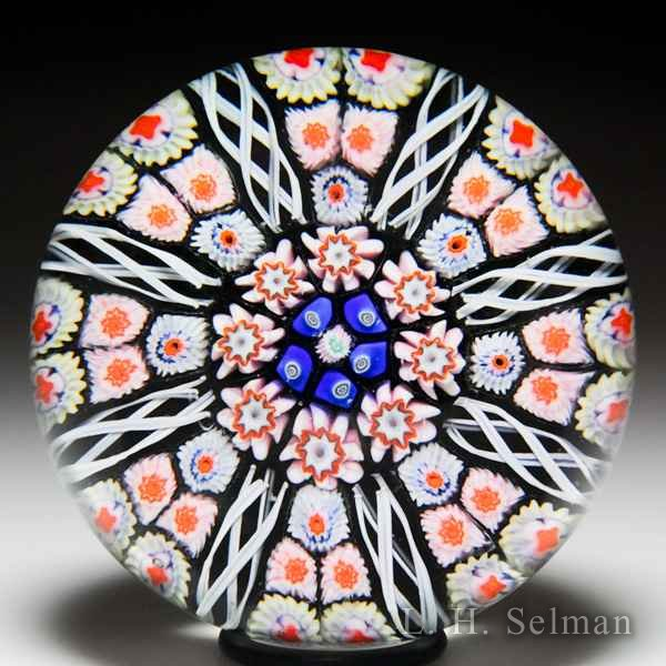Strathearn radial spokes on black ground glass paperweight. by  Strathearn Glass