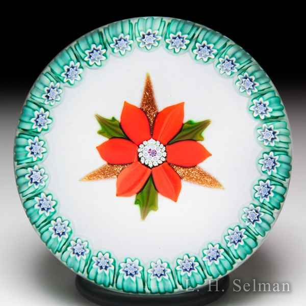 Peter McDougall 2010 L.H. Selman Ltd. Christmas poinsettia glass paperweight. by Peter McDougall