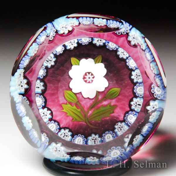 Peter McDougall 2008 Christmas rose miniature faceted glass paperweight. by Peter McDougall