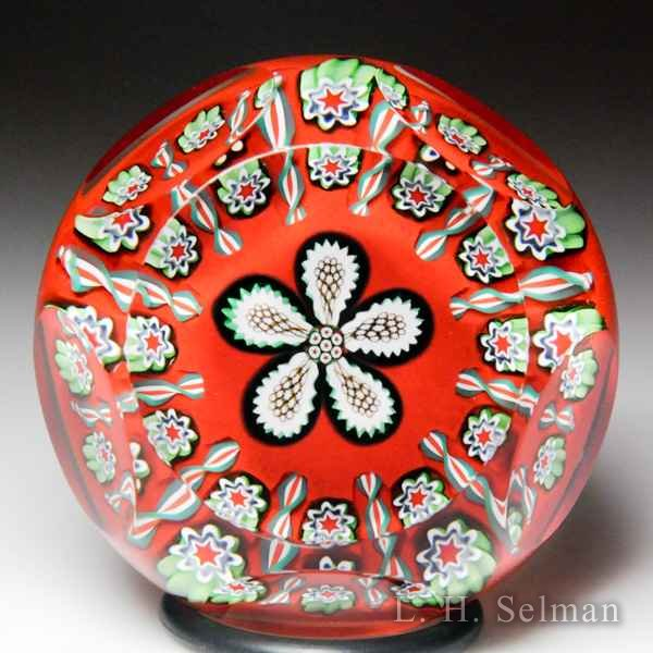 Peter McDougall (2011) Christmas millefiori flower miniature faceted glass paperweight. by Peter McDougall