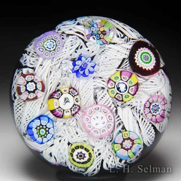 Perthshire Paperweights 1973 spaced millefiori on upset muslin over amethyst ground glass paperweight. by  Perthshire Paperweights