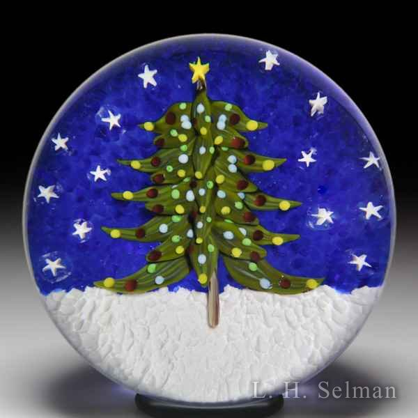 Bobbi Banford Christmas tree and stars paperweight. by Bobbi Banford