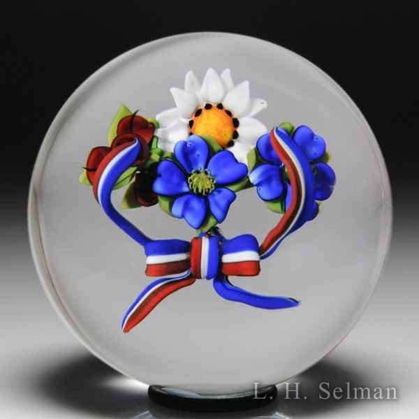 Ken Rosenfeld 2002 'Red, White and Blue Ribbon Bouquet' glass paperweight. by Ken Rosenfeld