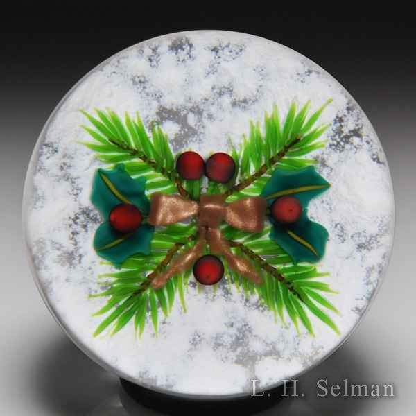 Ken Rosenfeld 2000 Christmas pine and holly with golden bow glass paperweight. by Ken Rosenfeld
