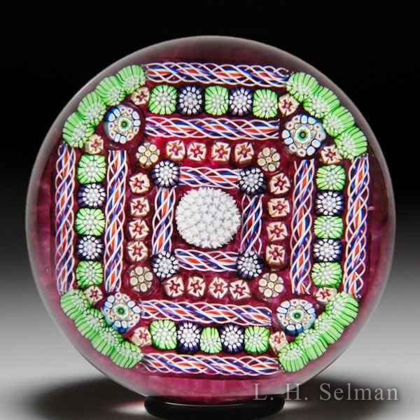 John Deacons 2017 'Fortress' square-patterned millefiori glass paperweight. by John Deacons