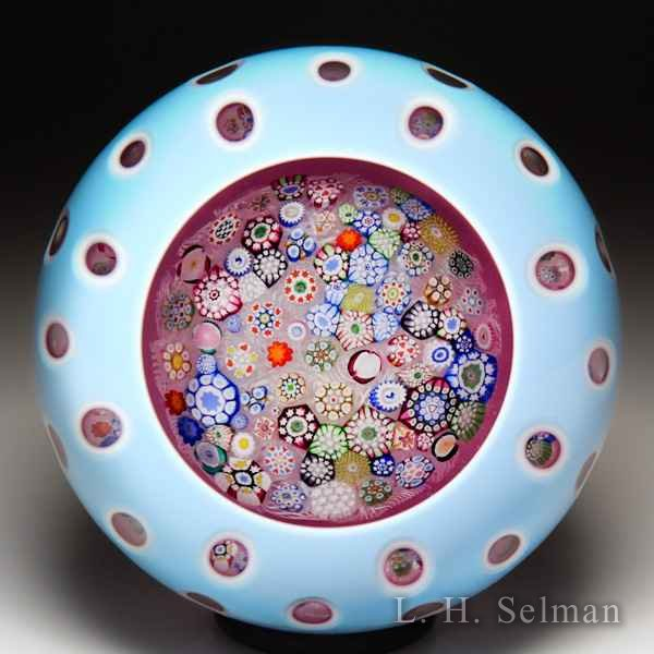 John Deacons 2017 close packed millefiori triple overlay faceted glass paperweight. by John Deacons