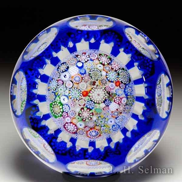 John Deacons close packed millefiori overlay faceted paperweight. by John Deacons