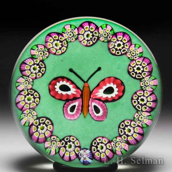 Paul Ysart butterfly and millefiori garland glass paperweight. by Paul Ysart