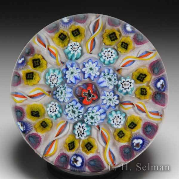 Strathearn patterned millefiori and radial twists glass paperweight. by  Strathearn Glass