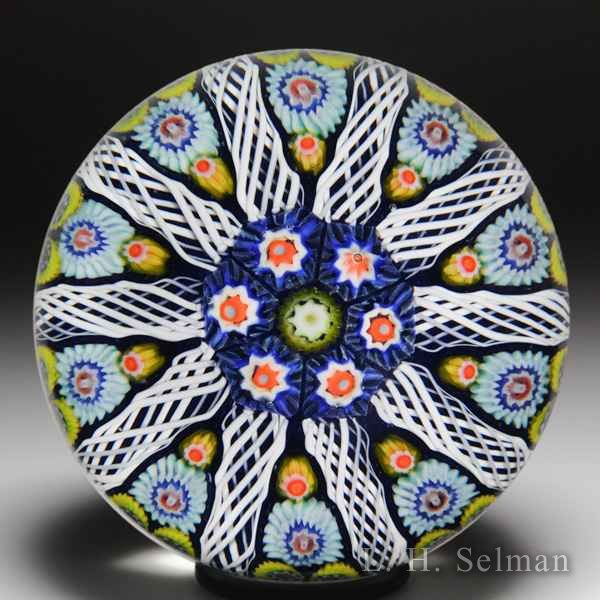 Strathearn patterned millefiori glass paperweight. by  Strathearn Glass