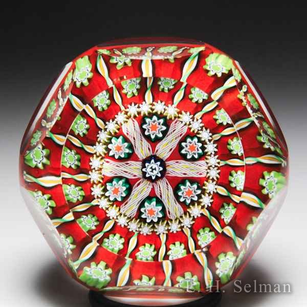 Peter McDougall radial patterned twists and millefiori faceted glass paperweight. by Peter McDougall