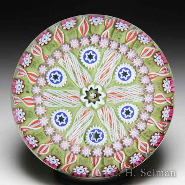 Peter McDougall radial spokes pattern glass paperweight. by Peter McDougall