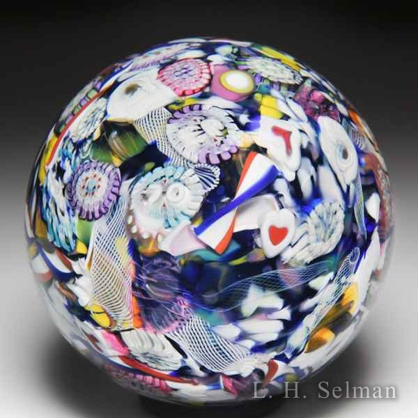 Mike Hunter 2018 hearts, wordcane, roses scrambled millefiori paperweight. by Twists Glass Studio