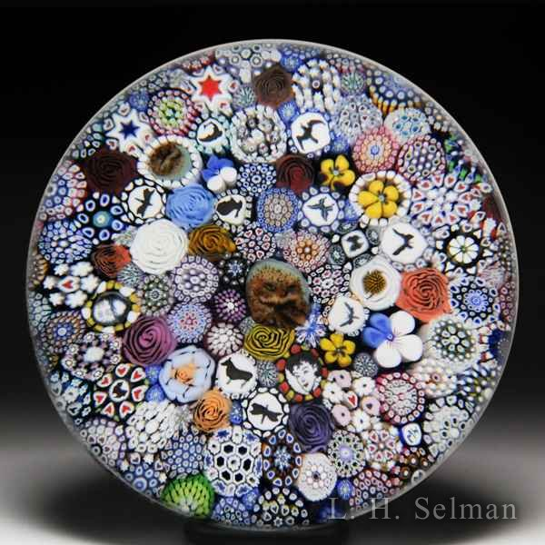 Mike Hunter 2018 close packed millefiori, flowers, silhouette and murrini magnum paperweight. by Twists Glass Studio