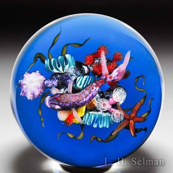 Ken Rosenfeld 2018 purple fish and coral glass paperweight. by Ken Rosenfeld