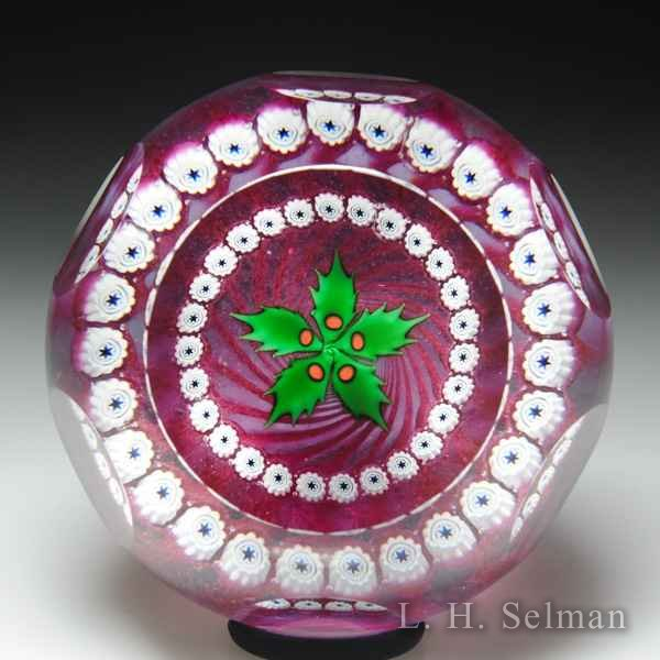 Caithness Glass (1986) 'Holly' and garland faceted glass paperweight, by Colin Terris. by Caithness  Glass Inc