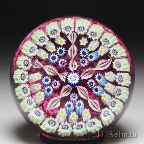 John Deacons (2018) pink patterned millefiori and twists glass paperweight. by John Deacons