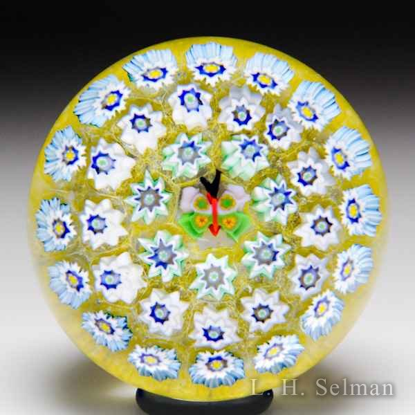 John Deacons (2018) butterfly cane concentric millefiori miniature glass paperweight. by John Deacons
