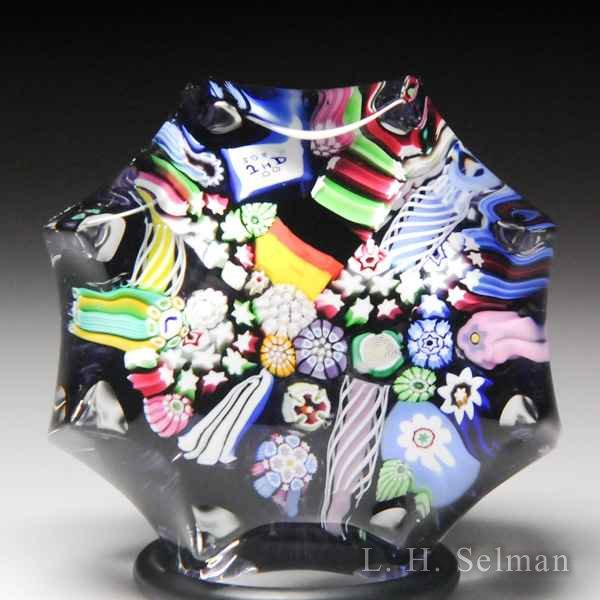 John Deacons (2018) end-of-day scrambled millefiori miniature glass paperweight. by John Deacons