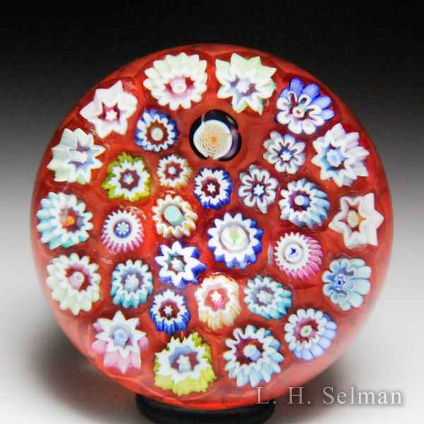 John Deacons (2018) close packed millefiori miniature glass paperweight. by John Deacons