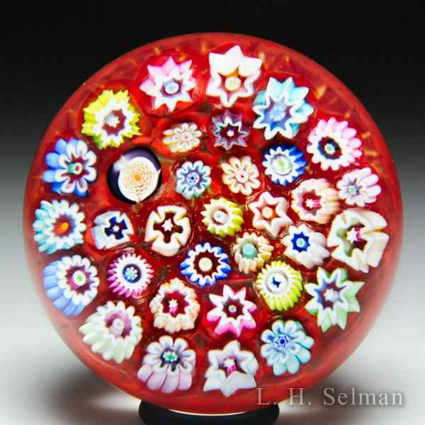 John Deacons (2018) close concentric millefiori miniature paperweight. by John Deacons