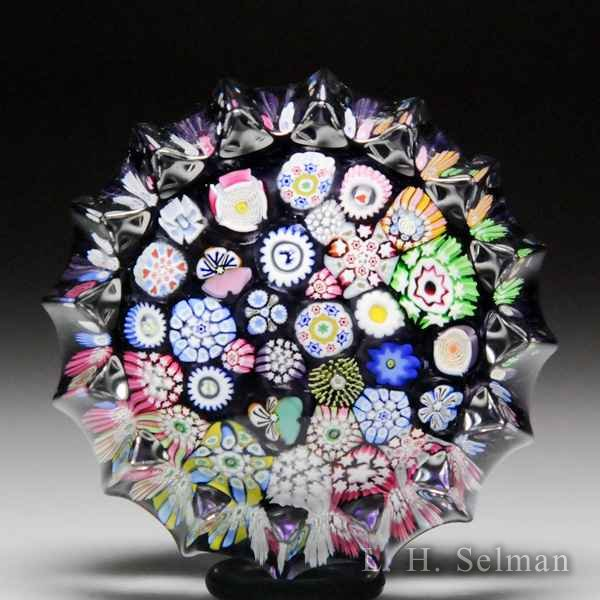 John Deacons (2018) end-of-day scrambled millefiori fluted miniature paperweight. by John Deacons