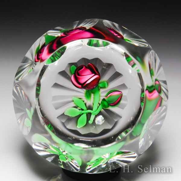 Perthshire Paperweights (1980) pink 'Rose and Bud' faceted glass paperweight. by  Perthshire Paperweights