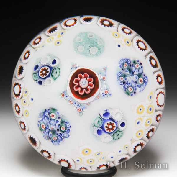 Antique Bacchus patterned millefiori circlets on sodden snow glass paperweight. by  English Antique