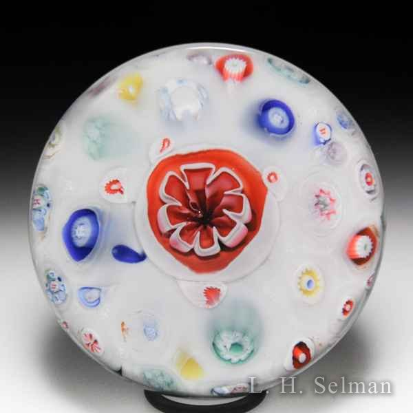 Antique Bacchus spaced concentric millefiori on sodden snow glass paperweight. by  English Antique