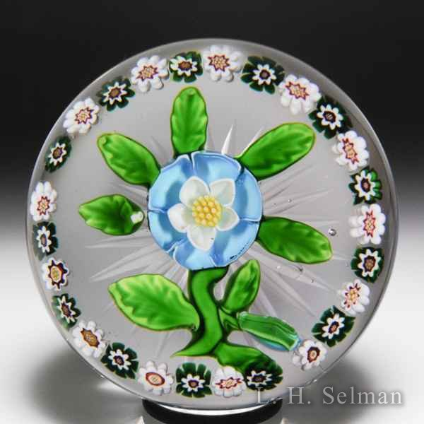 Antique Baccarat aqua buttercup and bud with millefiori garland paperweight. by Baccarat Antique